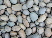 Stones background. Smooth stones background. closeup texture Royalty Free Stock Image