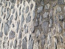 Stones background. Background of stone wall, of a mountain village wall Royalty Free Stock Image