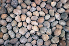 Stones background. Background Texture Of Beautiful Smooth And Colorful River Stones Royalty Free Stock Photography