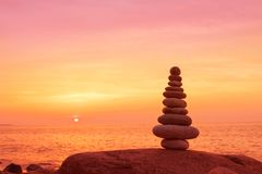 Stones balance on a background of sea sunset. Concept of harmony and balance. Stones balance on a background of sea sunset. Calm and meditation. Concept of Stock Photos