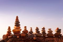 Stones balance on the background of the sunset sky on the beach royalty free stock photo