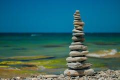 Stones balance on beach. Stones balance, pebbles stack over blue sea. Blue sky on sunny adriatic coast in summer royalty free stock image