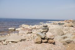 Stones balance on the beach. Place on Latvian coasts called Veczemju klintis.  royalty free stock image