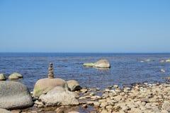Stones balance on the beach. Place on Latvian coasts called Veczemju klintis.  royalty free stock images