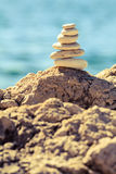 Stones balance at the beach, stack over blue sea Royalty Free Stock Photography
