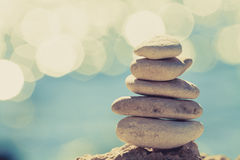 Stones balance at the beach, stack over blue sea Royalty Free Stock Photos