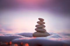 Stones balance. On beach, sunrise shot Stock Image