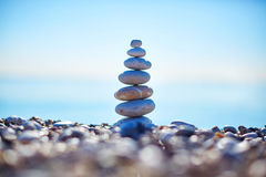 Stones balance on beach, sunrise shot Stock Image