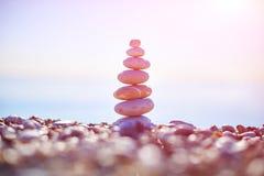 Stones balance on beach, sunrise shot Stock Images
