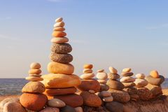 Stones balance in the evening sun on the beach. Concept of harmony, balance and meditation royalty free stock photos