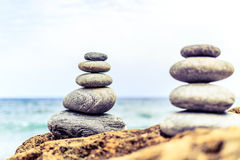 Stones balance inspiration wellness concept. Stones balance and wellness retro spa concept, inspiration, zen-like and well being tranquil composition. Close-up royalty free stock photo