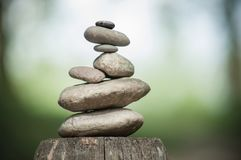 Free Stones Balance On Wooden Fence On Green Blurred Backg Stock Photos - 116385353