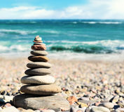 Stones balance, pebbles stack over blue sea in Crimea. Blue sky on sunny  coast in summer Stock Photo