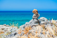 Stones balance on a rocky coast in the background of the sea. royalty free stock photos
