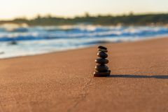 Stones Balance in sunrise. At sea in summer Royalty Free Stock Photos