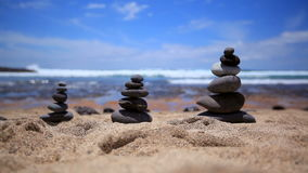 Stones balance on vintage beach, inspirational summer. Picturesque sea landscape. Tenerife. Ocean. Sea waves. Beach.