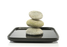 Stones in balance in water Stock Image