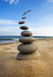 Stones balanced  and fly in zen style. Royalty Free Stock Photography
