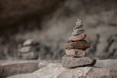 Stones in balanced pile. At the side way to the Pha Tam cliff northeast of Thailand Stock Photo