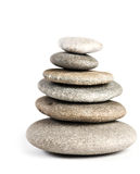 Stones in balanced pile. On white Stock Images