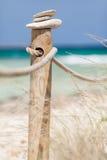 Stones balanced on wooden banister. Stock Photo