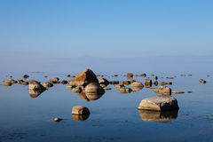 The stones into the Baltic sea on beauty horison Royalty Free Stock Photography