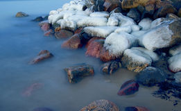 Stones of Baltic sea covered by melting ice Royalty Free Stock Photography