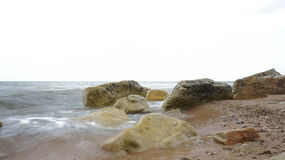 Stones of the Baltic Sea. Sea waves, rocks and sand Stock Photo