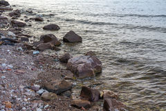 Stones on the bank of the river, summer evening. On the river Volga Royalty Free Stock Photo