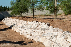 Stones barricade. To prevent landslides on a small yard stock photo