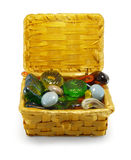Stones in the basket. Semi-precious stones, crystals in the basket, isolated royalty free stock images
