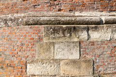 Stones and bricks in bastion. Sopron, Hungary. Ancient brickwork and some bigger carved stones built in the Italian style bastion called Great Rondella built in royalty free stock photo