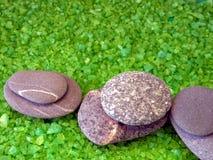 Stones on bath salt Royalty Free Stock Photos