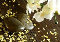 Stones, bath salts and orchid flower Royalty Free Stock Photo