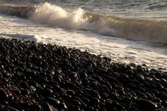Stones beach. A beach with black stones Stock Photo