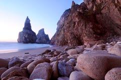 Stones & beach. Praia da Ursa beach with stones in Cabo da Roca, Portugal, at sunset Stock Photo