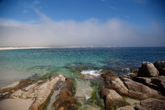 Stones at the beach are going to the water, Atlantic Islands National Park, Spain Stock Images