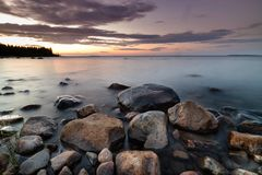 Stones on beach in Pitea in Sweden during summer sunset. Long exposure Royalty Free Stock Photo