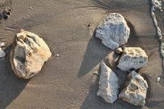 Stones on the beach. Stones on a sandy beach Stock Photo
