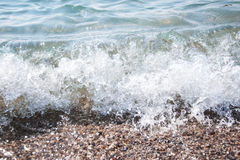 Stones on beach and sea water Royalty Free Stock Photography