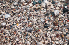 Stones on beach and sea water Royalty Free Stock Photo
