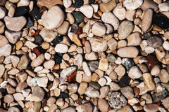 Stones on beach and sea water Stock Photo