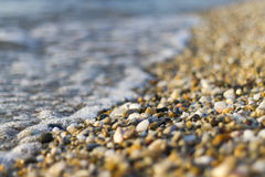 Stones on beach and sea water. Selective focus stock photography