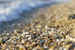 Stones on beach and sea water. Selective focus stock photo