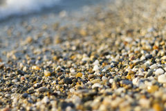 Stones on beach and sea water. Selective focus royalty free stock photo