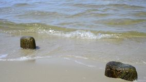 Stones at a beach with soft break-wave at the Baltic sea Royalty Free Stock Photography