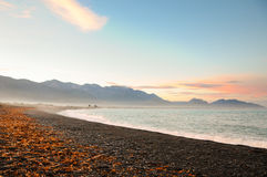 Stones on the Beach in the Sunset, New-Zealand. New Zealand is a country of stunning and diverse natural beauty: jagged mountains, rolling pasture land, steep Royalty Free Stock Photo
