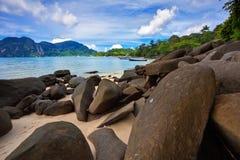 Stones beach under blue sky Royalty Free Stock Photo
