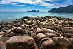 Stones beach under blue sky Stock Image