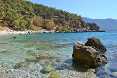 Stones in a beautiful azure sea bay stock photos
